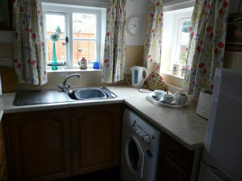 Small well equipped kitchen with Zanussi oven, fridge freezer, washing machine, microwave, toaster