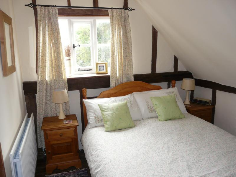 Light airy double bedroom with view out over the garden, double fitted wardrobe and dressing table