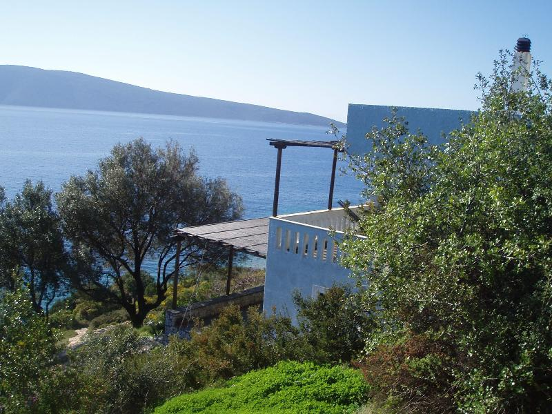 Side view of the villa and the sea below.