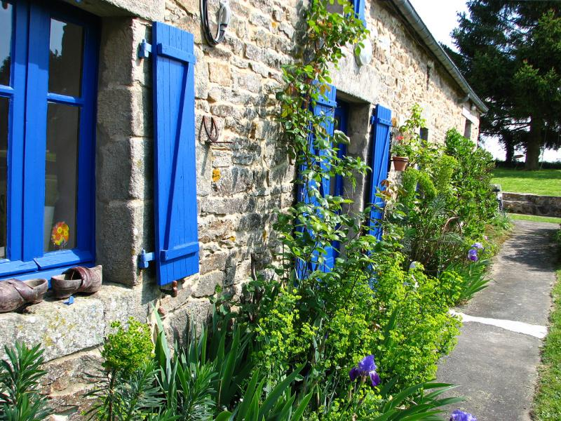 The cottage is surrounded with flower borders containing a variety of cottage perennials.