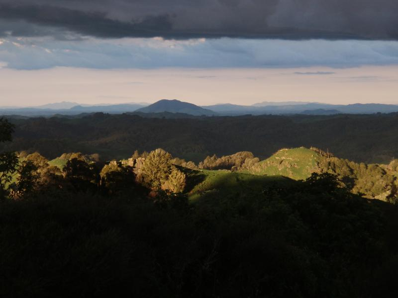Afternoon sun looking towards Coromandel peninsula.Mount Kakepuku in foreground.