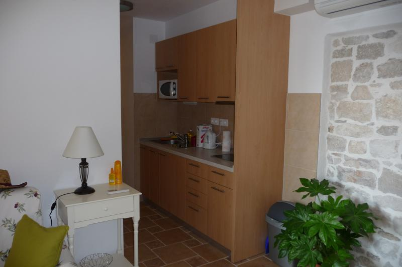 Olive Apartment has a self-contained kitchen area, equipped with electric hob, microwave, fridge