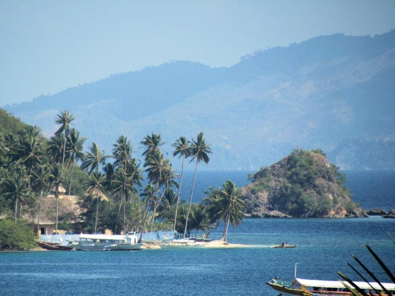 Camera zoom of Puerto Galera Bay. Fun to keep track of construction of the new island resort