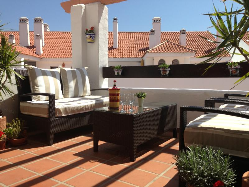 Relax on the comfortable seating on the sunny terrace.
