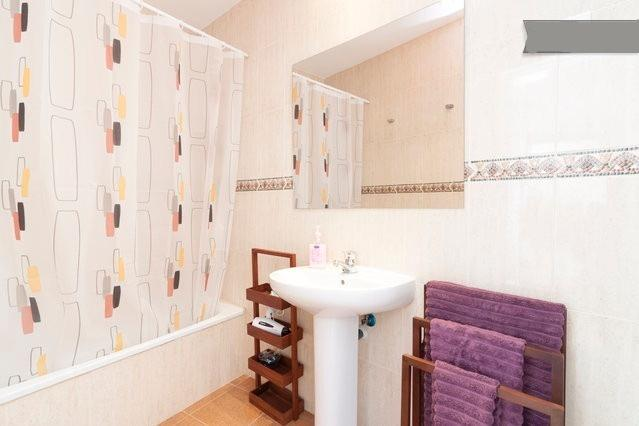 Fully equipped bathroom with tub