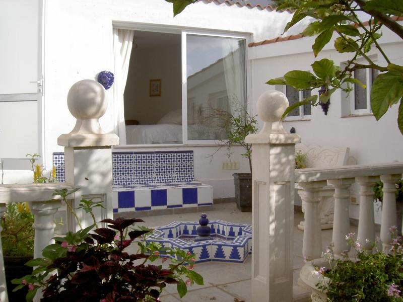 Lovely detached villa - your master suite overlooks courtyard and garden