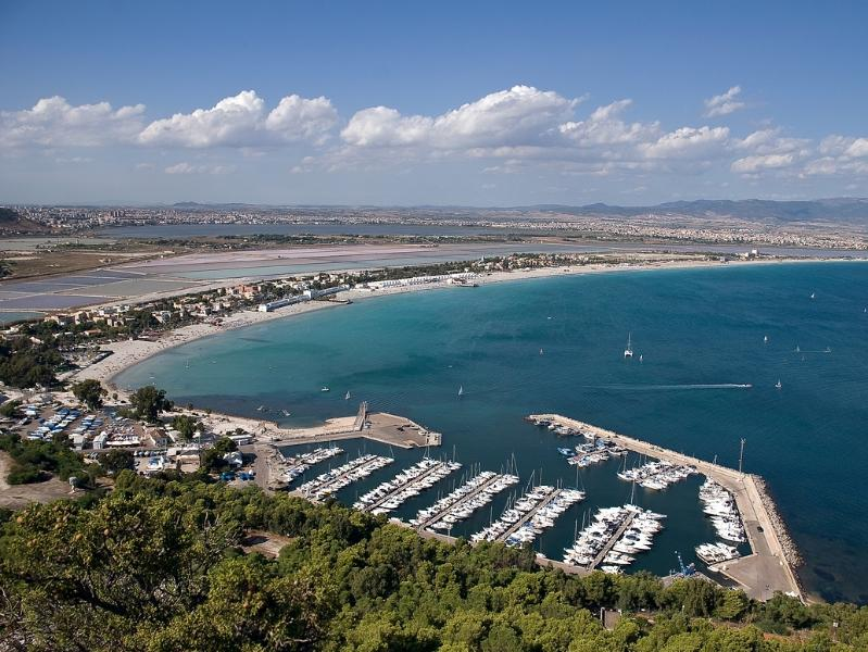 Marina Piccola port with Poetto beach on background
