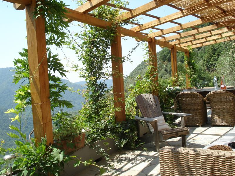 The outdoor living room where you can relax on the comfortable sofa or have an Italian diner on the