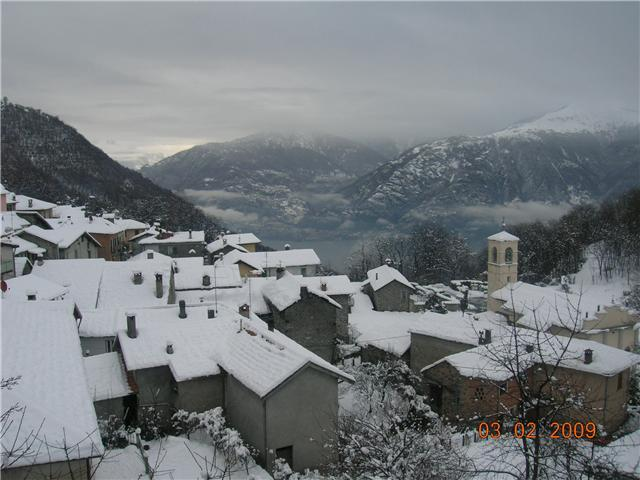 Breglia in winter with snow - view from the room