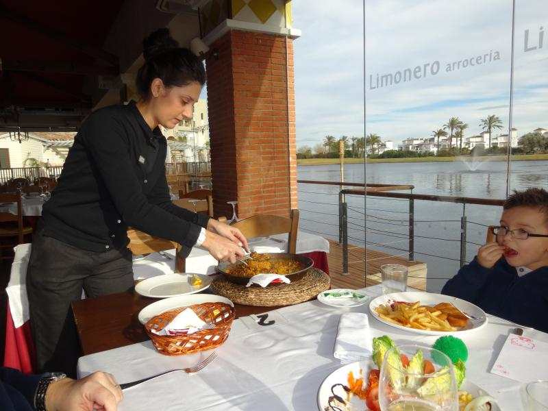 Enjoy a traditional paella overlooking the lake
