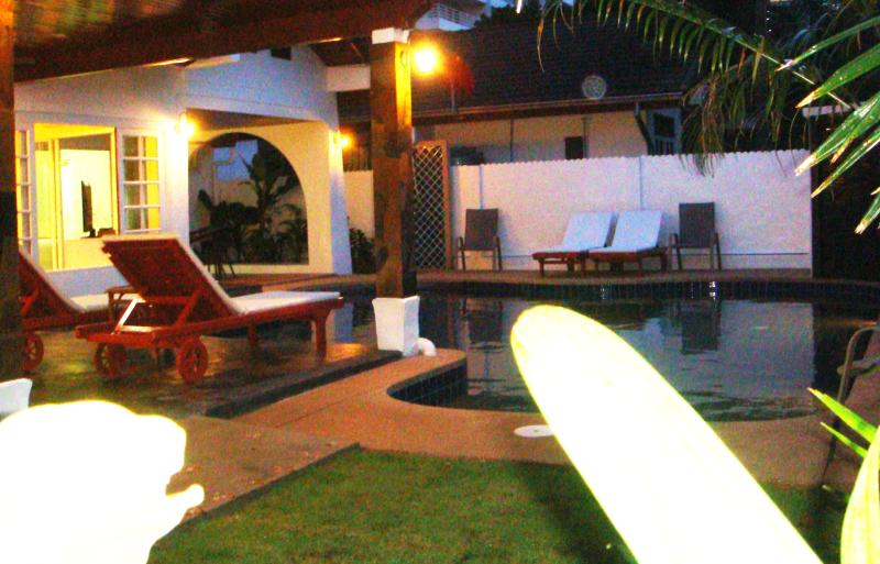 evening view from entrance looking to pool n seating area