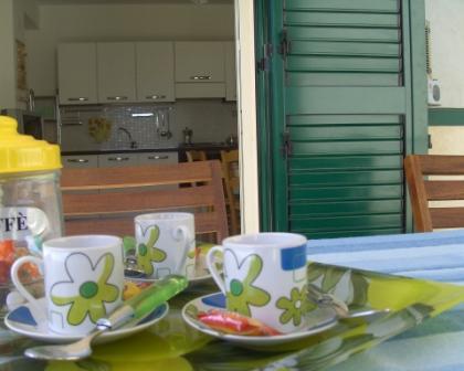 nella veranda coperta puoi consumare tutti i tuoi pasti all'aria aperta