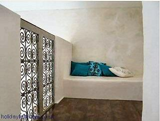 The Moroccan styled mezanine can be made into an extra bed.