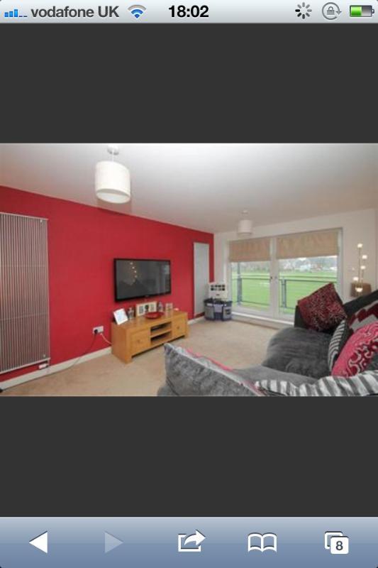 sala de estar com sofá-cama e sofá