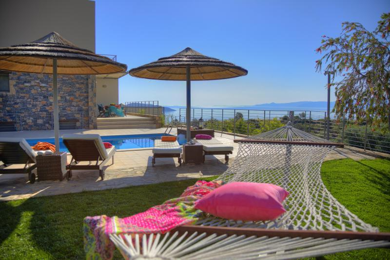 A hammock and enough sunbeds for everyone will be waiting for you by the pool