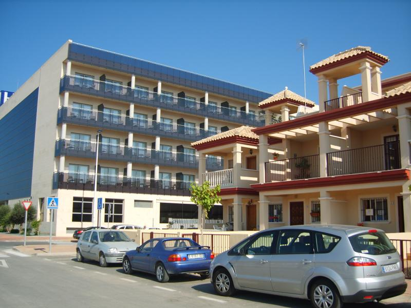 Front view of house with Thalasia Hotel in background