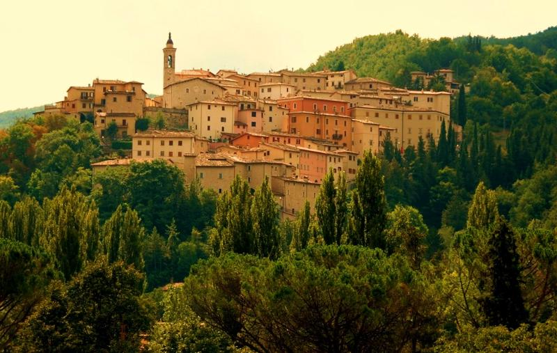 The beautiful Umbrian hill village of Preci - the white house to the right of the church