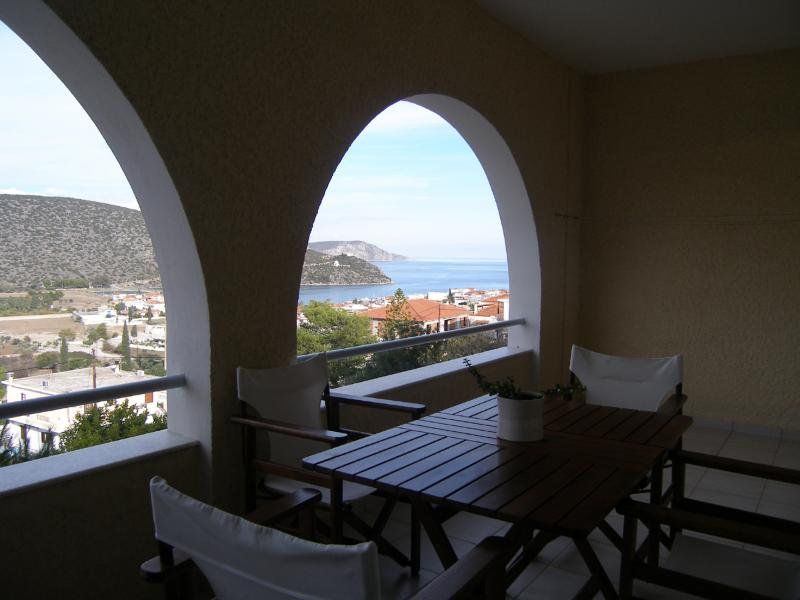 A private balcony for outdoor dining with the best view of the village and the sea