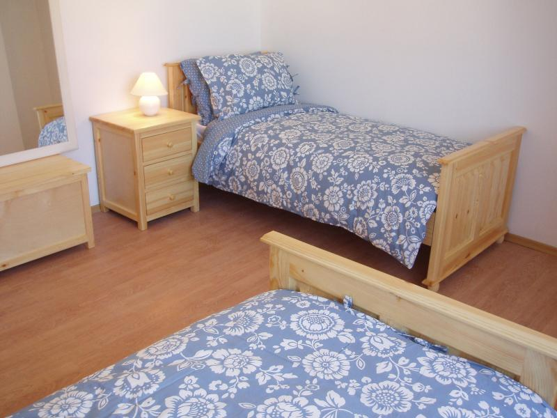 Twin bedroom with warm 15 tog duvets.