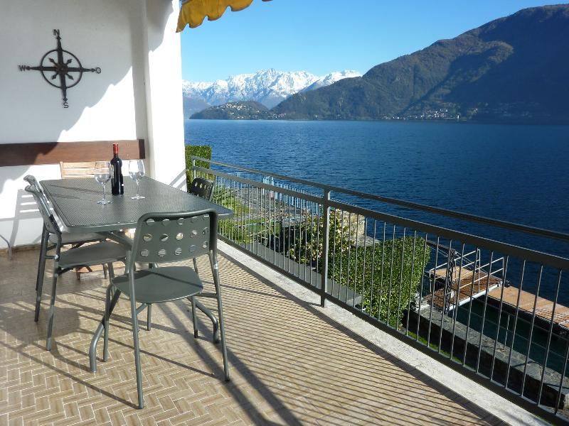 Six guests can dine a la fresca on outdoor furniture on top terrace with lake/mountain views