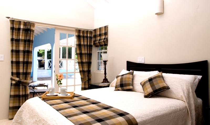 Spacious and light master bedroom tastefully furnished for a relaxing atmosphere