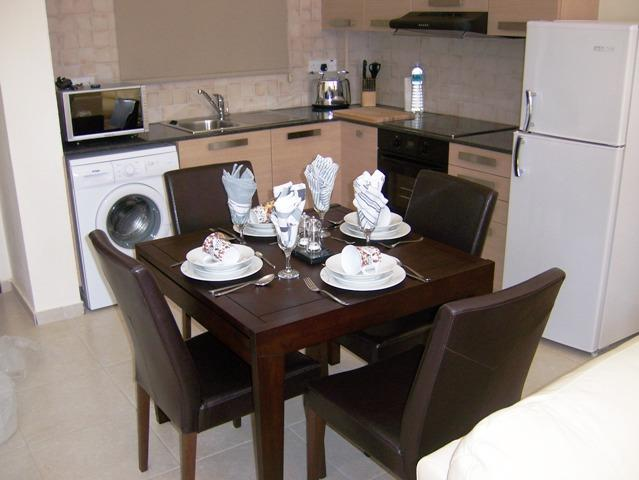 An open plan kitchen, dining area