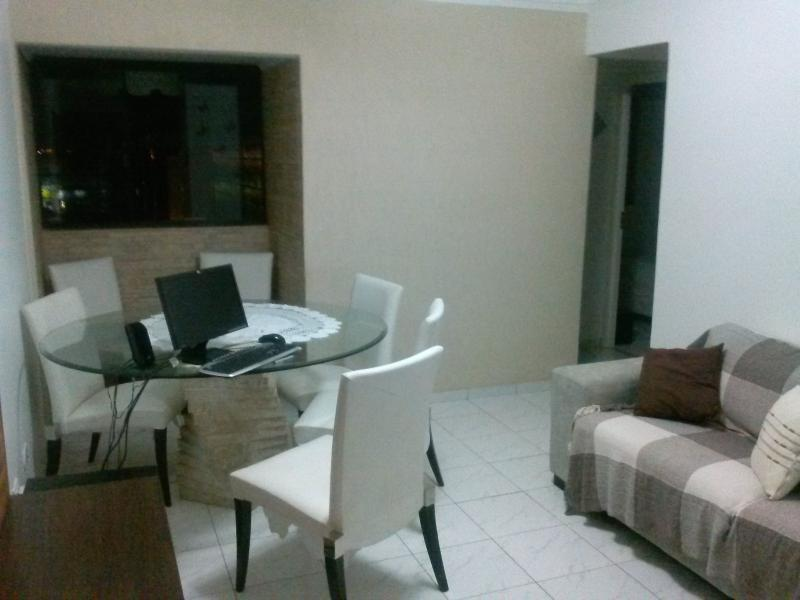 Large living room, with a table for six people, only three seats, 40 LCD tv, of 14 inches.