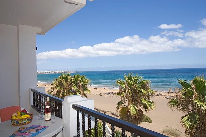 Apartment overlooks the beach and sea.