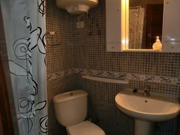 Ensuite shower room 2 with shower, toilet,handbasin & vanity unit.