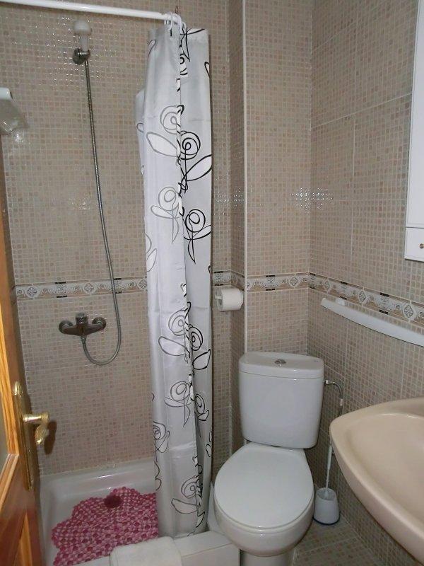 Ensuite shower room for bedroom 1 with shower,toilet,handbasin&vanity unit.