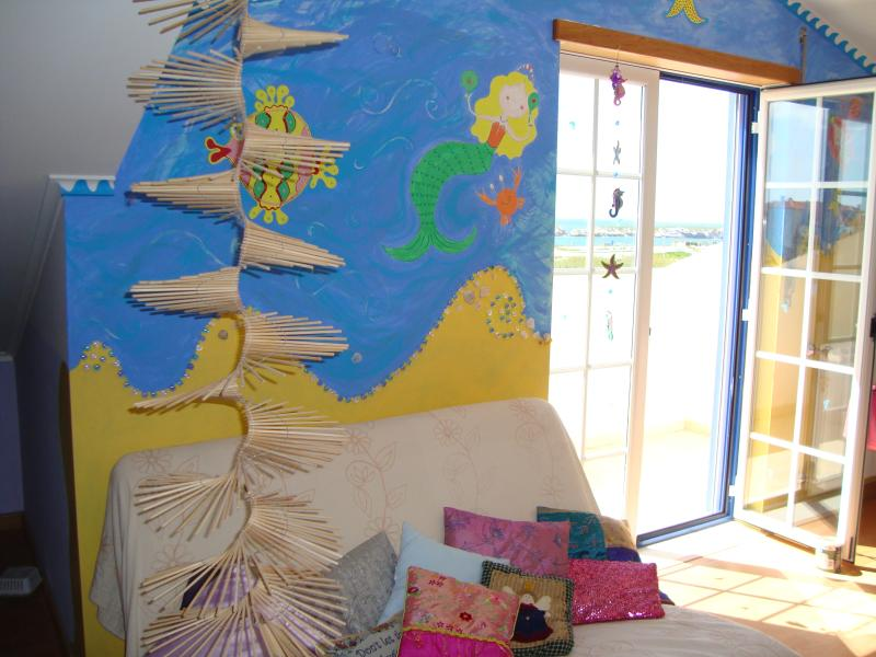 Mermaids in the attic room and your sure to fine them looking out from the balcony towards the sea!
