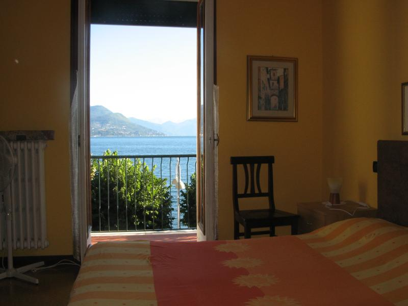 Master bedroom facing the lake with balcony