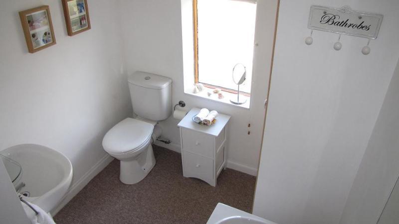 Bathroom with bath and shower.