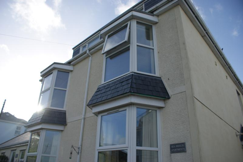 Flat 3 is the upstairs flat with the open window.