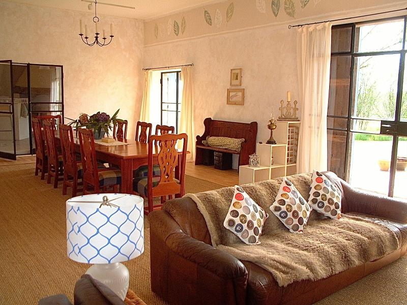 Has a luxurious, loft style lounge dining area with wood burning stove.