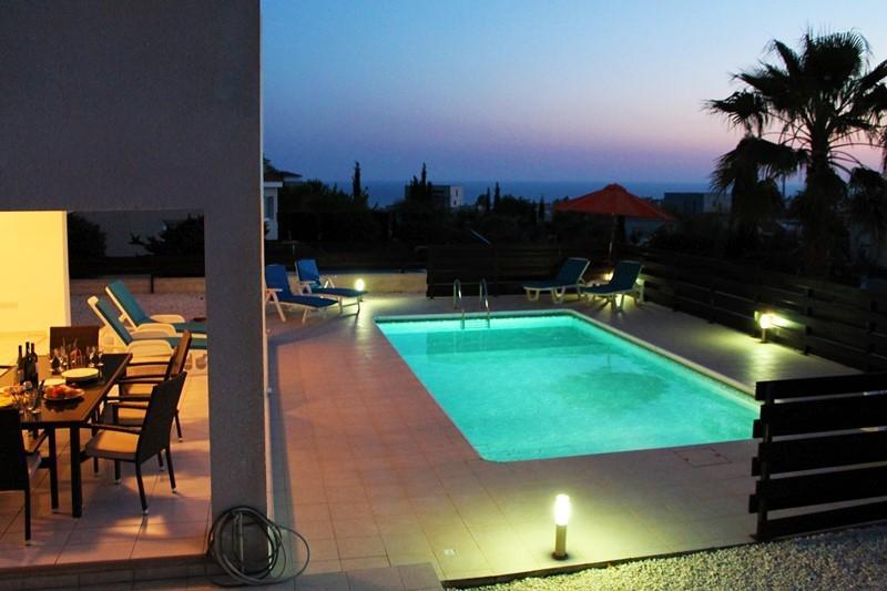Emelita Pool Area and Views at Night