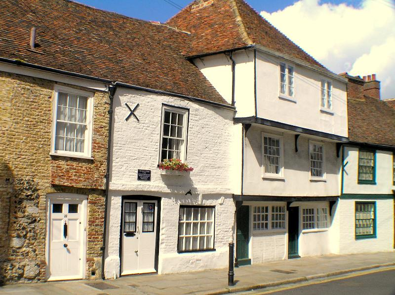 Tom Paine's cottage is the white cottage on the left, its right in the heart of Sandwich.