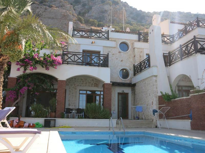A beautiful luxury villa with 4 bedrooms, each with private balconies, set over 3 floors