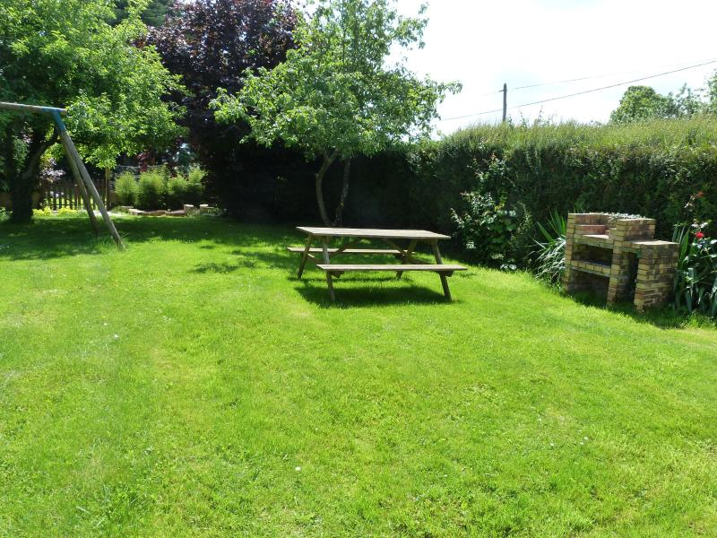 Shared garden area with swings, picnic table and BBQ