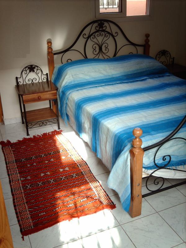 Double bed bedroom with bathroom