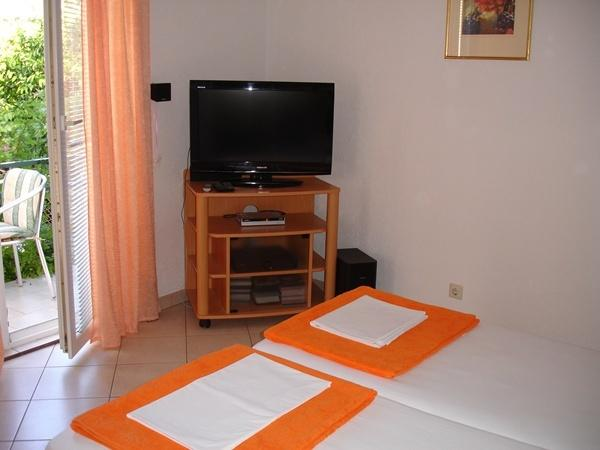 The bedroom with TV set