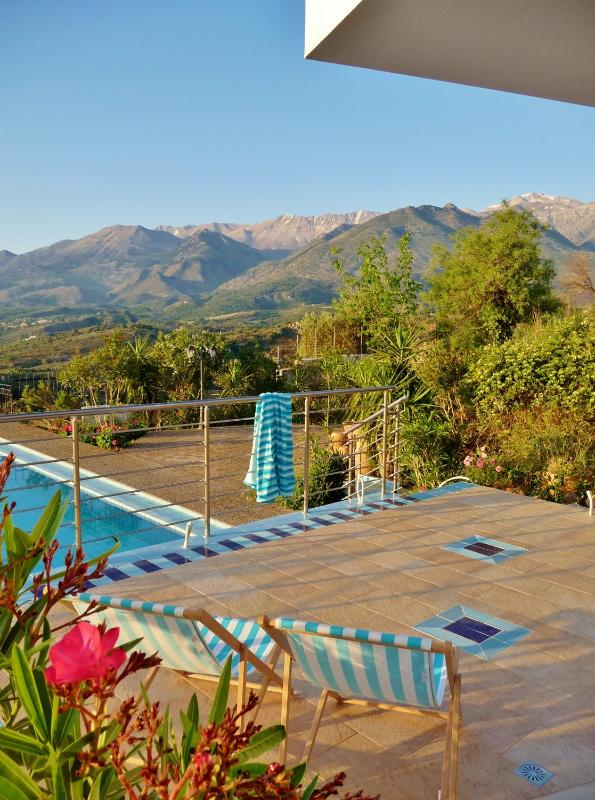 Relax on the pool terrace, with views of the White Mountains