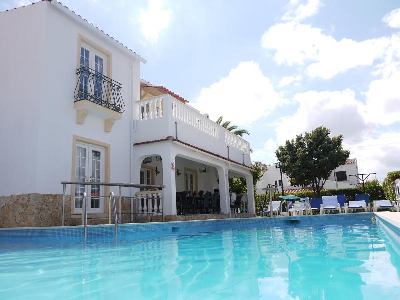 Large L-shaped swimming pool and rear of Villa Sereia
