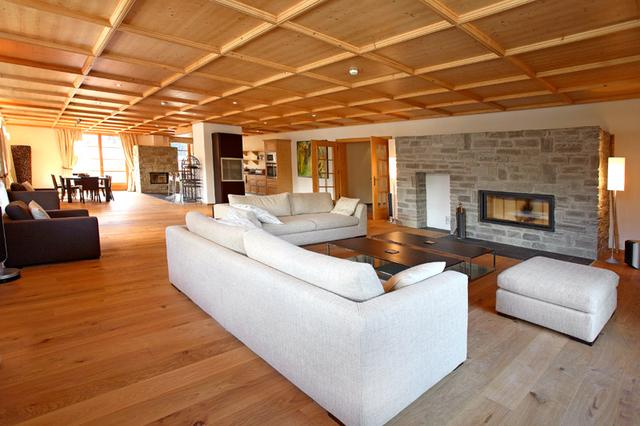 Spacious living area with two log fireplaces.