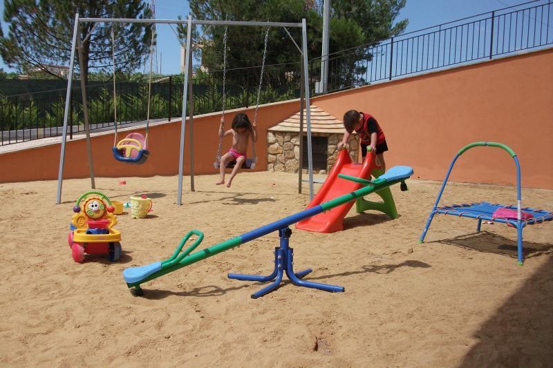 Superb large sandpit full of swings, slide, little trampoline, sea-saw, bucket & spades & mu