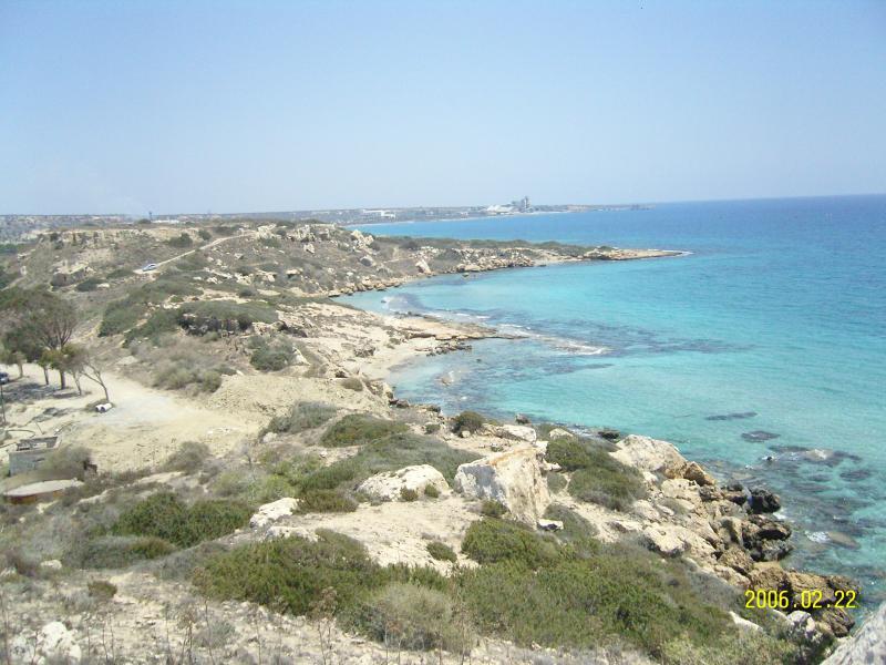 Coastline behind villa with hidden sandy cove.