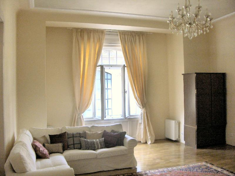 The sitting room which is spacious and elegant with parquet floor, chandelier,  Turkish rugs.