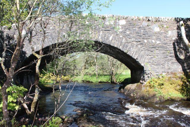 Clachandubh Bridge over the burn which runs past the cottage.