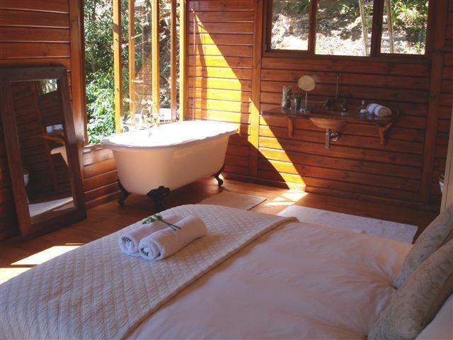 The en-suit bath has magnificent views to the mountains