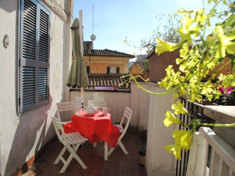 TERRACE HAS A LARGE SUN-UMBRELLA FOR THE HOTTER MONTHS